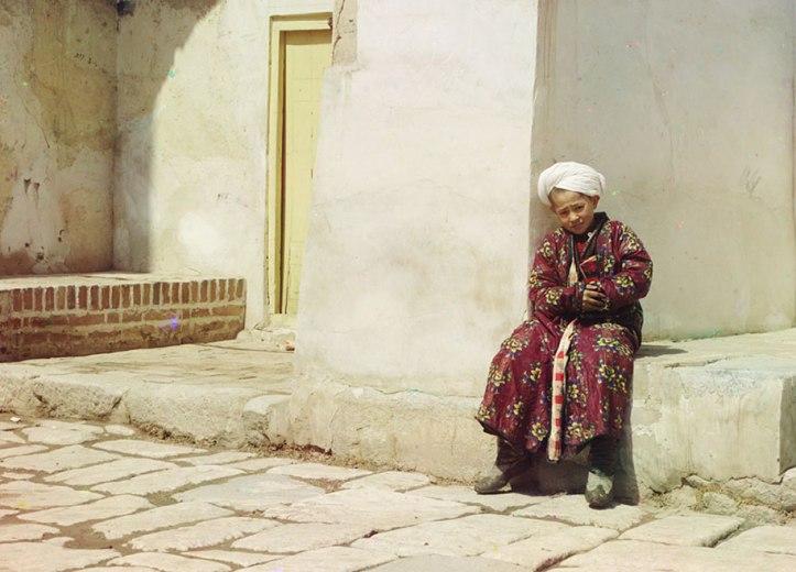 1-A-boy-sits-in-the-court-of-Tillia-Kari-mosque-in-Samarkand-present-day-Uzbekistan-ca.-1910