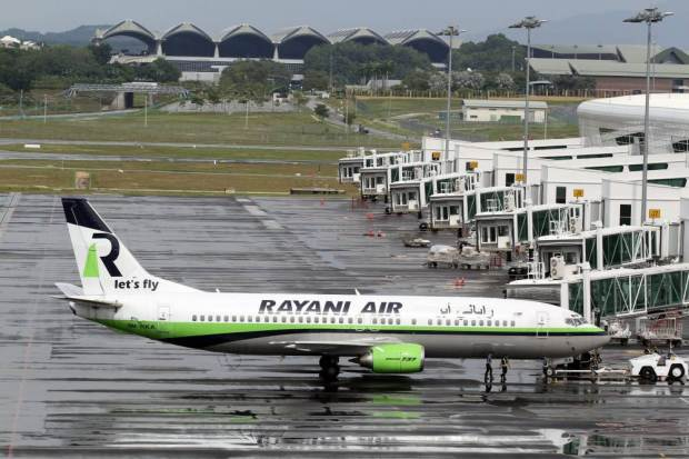 epa05077469 A picture made available on 21 December 2015 shows a Rayani Air aircraft, Malaysia's first Islamic-compliant airline, parked at Kuala Lumpur International Airport 2, in Sepang, Malaysia, 20 December 2015. The airline will not consent any pork or alcoholic beverages on board and Islamic prayers will be conducted before every flight for the safety of the crew and passengers. Muslim crew members will be obliged to cover their heads and non-Muslim members of the crew are required to dress decently in accordance to Shariah requirements. EPA/AFIQ RAZALI MALAYSIA OUT