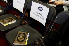Copies of the Koran sit on chairs, including those reserved for White House staff members, in a room prepared for remarks by U.S. President Barack Obama at the Islamic Society of Baltimore mosque in Catonsville, Maryland February 3, 2016. REUTERS/Jonathan Ernst