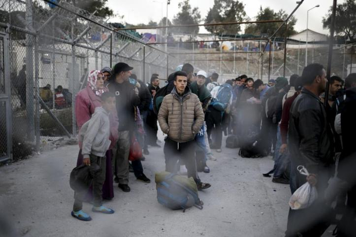 Refugees and migrants wait to be registered at the Moria refugee camp on the Greek island of Lesbos