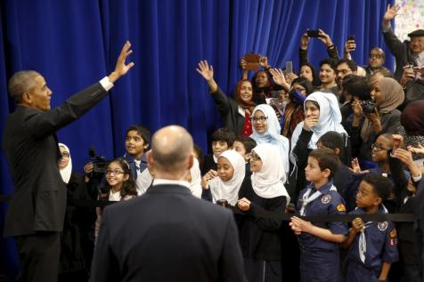 President Barack Obama waves farewell to students after his remarks at the Islamic Society of Baltimore mosque in Catonsville, Maryland February 3, 2016. REUTERS/Jonathan Ernst