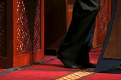 President Barack Obama goes without shoes, out of deference, as he delivers remarks at the Islamic Society of Baltimore mosque in Catonsville, Maryland February 3, 2016. REUTERS/Jonathan Ernst