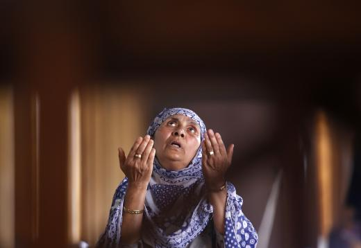 A Muslim woman prays inside Jamia Masjid during the holy fasting month of Ramadan in Srinagar