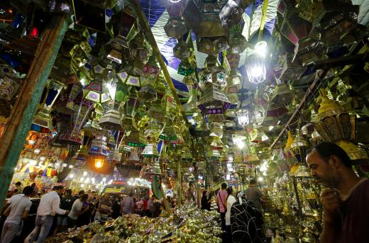 People browse around stalls selling festival lights and Ramadan lanterns at Sayida Zienab district market during the first day of Ramadan in old Cairo