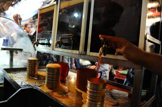 A vendor pours traditional Ramadan drink on the first day of the holy fasting month of Ramadan in Tripoli